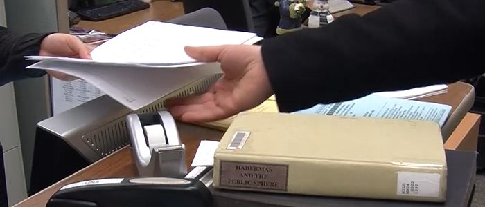 Someone using Interlibrary Loan to receive E-Z Borrow materials