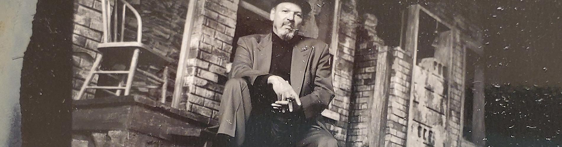 August Wilson sitting on steps.