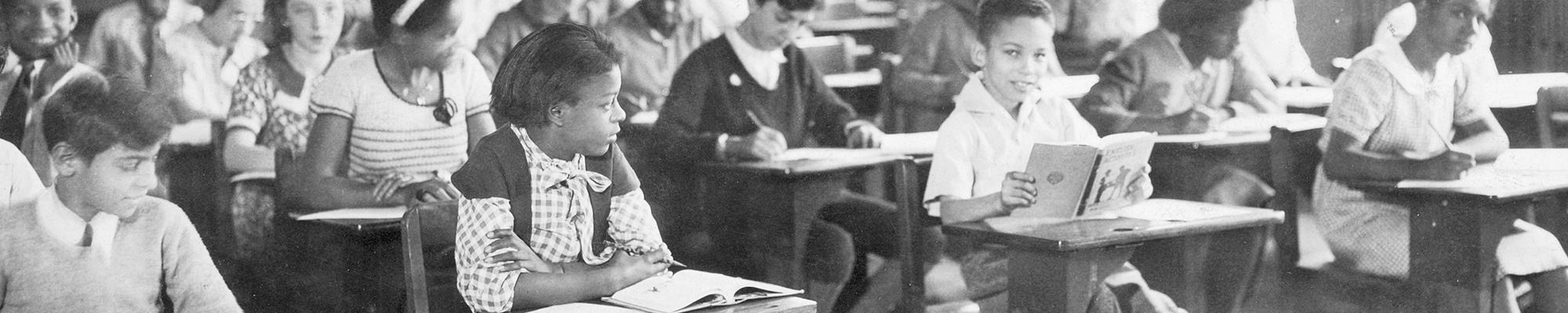 Students sitting at their desks doing work. Circa 1940-1950.