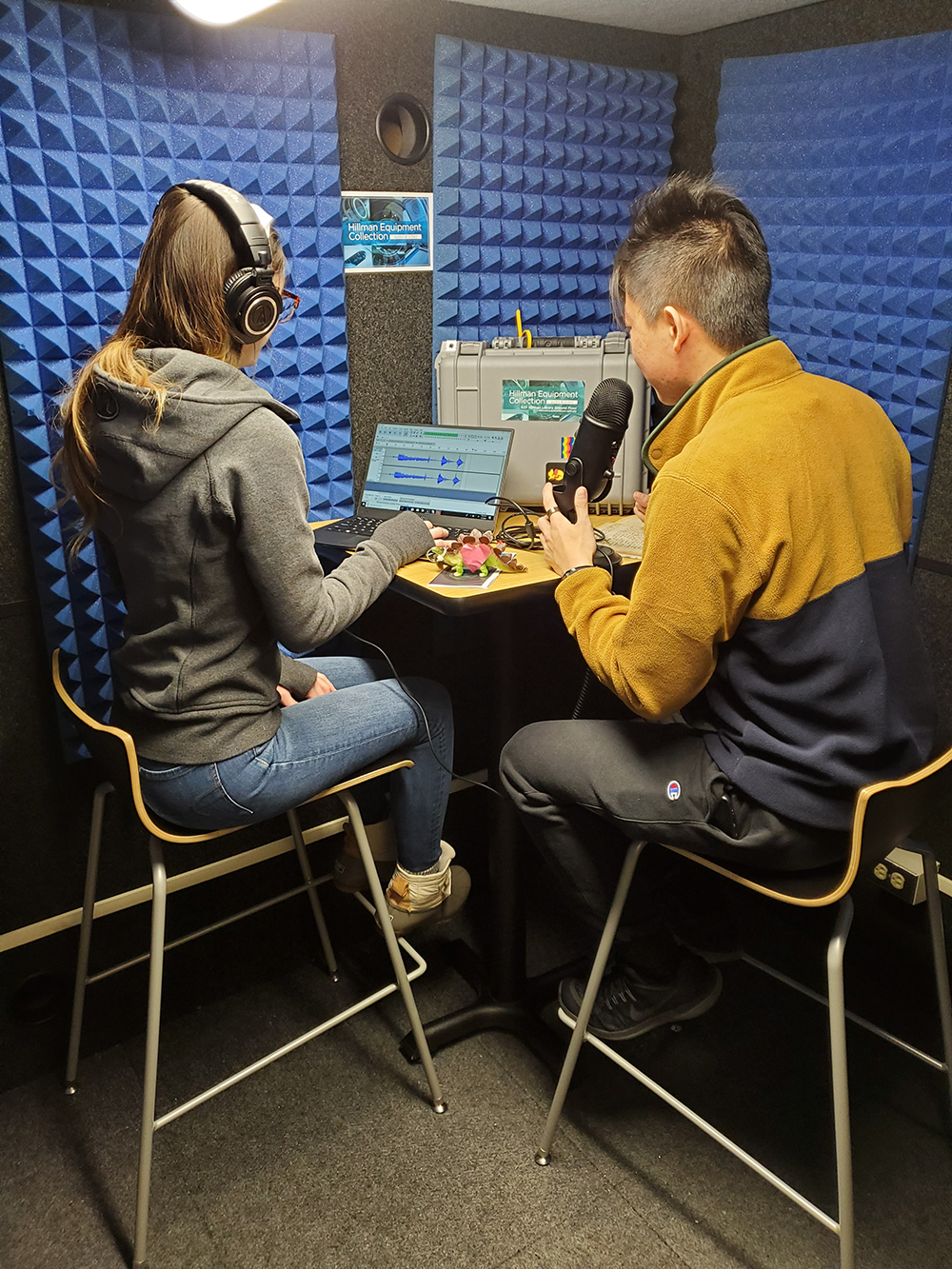 Two students in the Whisper Room recording a podcast.
